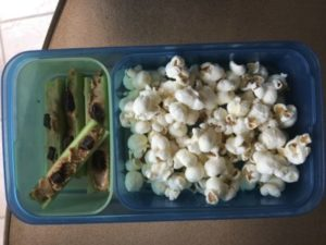 Popcorn and Celery Sticks with Almond butter and dark chocolate chips